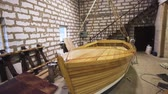 кинжал : Wooden boat with sail mast within workshop. steadicam shoot. Homemade Sailbaot ready to move in sea, lake, or river. Big hobby concept. Close-up
