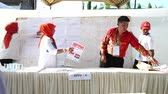 indonesian election : Banda Aceh, Indonesia - April 17, 2019: Officials sort and fold ballots for 2019 elections at a General Elections Committee (KPU) Polling Station In Kampung Mulia Banda Aceh, Aceh Province. Stock Footage