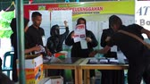 indonesian election : Banda Aceh, Indonesia - April 17, 2019: Officials sort and fold ballots for 2019 elections at a General Elections Committee (KPU) Polling Station In Pelanggahan Banda Aceh, Aceh Province.