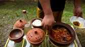 Cooking beef curry in clay pot in clay pot