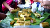 Lemang Bamboo or sticky rice with coconut milk sale at ramadhan street food market in Indonesia 動画素材