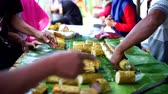 Lemang Bamboo or sticky rice with coconut milk sale at ramadhan street food market in Indonesia Vídeos