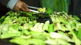 coal plant : Food Vendor grilled Sticky Rice at Indonesian Traditional Cake bazaar Stock Footage