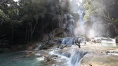laosz : Wonderful Tad Kuang Si Waterfall in Laos Stock mozgókép