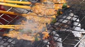 Traditional Asian BBQ on wooden sticks closeup