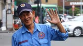 indočína : Ho Chi Minh City, Vietnam-January 11,2017: A video reportage on the streets of Saigon. A portrait of a friendly Vietnamese guard who is happy to see a foreigner of European appearance.