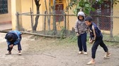 without internet : Sapa, Vietnam - December 01 ,2016 : Ethnic minority children playing a game with spinning tops, in a rural area near Sapa, Vietnam. Stock Footage