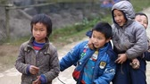 меньшинство : Sapa, Vietnam-December 01,2016:A charismatic boy belonging to ethnic minorities Hmong with pleasure grimaces and poses in front of a foreign camera.