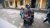 бедный : Sapa, Vietnam - December 01, 2016 : Ethnic minority children at school.The building serves as a kindergarten for children from nearby villages.