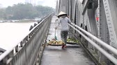 купец : Street vendor. Woman porter of fresh fruit in Vietnam