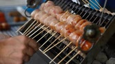 Asian street food . BBQ , Grill on sticks . Fast Food in asian countries Stockvideo