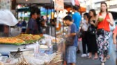 Street food market in Asia . Asian food. Abstract blur tourist buys Asian street food