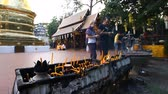 Чеди : Many prayer spiritual candles in the Thai temple.Traditions Of Buddhism.Faith and religion.Prayer