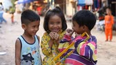backwater : Siam Reap, Cambodia - January 14, 2017: Three cheerful Cambodian children living in a poor Cambodian village.