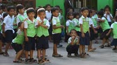 kamboçyalı : Siam Reap, Cambodia - January 12, 2017: Many Cambodian schoolchildren from junior classes in school uniforms