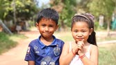 cambojano : Siam Reap, Cambodia - January 13, 2017: Video portrait of young children from a Cambodian village.