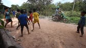 backwater : Siam Reap, Cambodia - January 13, 2017: Cambodian children play football on the road in their poor village . Living in poor settlements and slums in Cambodia