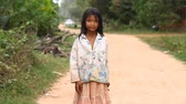 scarcity : Siam Reap, Cambodia - January 13, 2017: Video portrait of a little Cambodian girl . Children from poor villages and slums in Cambodia .
