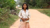 backwater : Siam Reap, Cambodia - January 13, 2017: Video portrait of a little Cambodian girl . Children from poor villages and slums in Cambodia .
