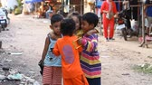 cambojano : Siam Reap, Cambodia - January 14, 2017: Three cheerful Cambodian children living in a poor Cambodian village.