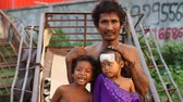 scarcity : Siam Reap, Cambodia - January 14, 2017: A homeless drug addict lives with his young children in a spontaneous house of boxes and construction debris.