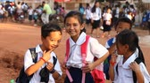 третий : Siam Reap, Cambodia - January 12, 2017: A group of Cambodian schoolchildren returning home after school .