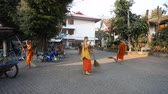 köntös : Chiang Mai,Thailand-February 14 ,2017:A group of young Buddhist monks cleans the territory of their monastery from fallen leaves. The life of Thai monks.