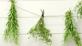 rosmarinus : Single twigs of Thyme and Rosemary on Wooden Board. Stock Footage