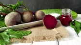 borscht : Beetroots on white painted rustic wooden table with slate background. Stock Footage