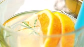 citrus fruit recipe : Detox water orange cocktail on wooden table. Stock Footage