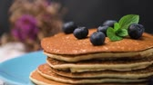 conserva : Delicious golden pancakes with fresh blackberries.