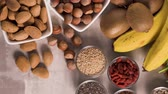 seçim : Superfoods on a gray background with copy space. Nuts, beans, greens and seeds. Healthy vegan food.