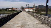 point of interest : PONTE DE LIMA, PORTUGAL - CIRCA APRIL 2018: Roman bridge crossing the Rio Lima in Ponte de Lima on the Camino de Santiago.