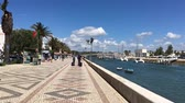 riverbank : LAGOS, PORTUGAL - CIRCA MAY 2018: Hyperlapse on theAvenida dos Descobrimentos with tourists walking, Lagos, Algarve, Portugal,