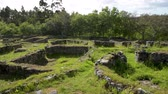 celta : The Castro de Romariz is a fortified settlement dating from the 5th century BC, with occupancy levels up to the first century AD. Romariz - Santa Maria da Feira, Portugal. Stock Footage