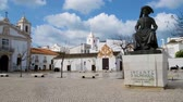 princ : LAGOS, PORTUGAL - CIRCA MAY 2018: Statue of Infante Dom Henrique (Prince Henry) in the town square with town buildings to the rear, Lagos, Algarve, Portugal.