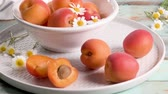 canned food : Delicious ripe apricots fruit on wooden background close up.