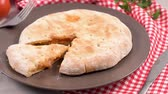 molho : Italian food, pizza calzone with tomato, spinach and cheese on wooden background.