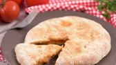 salam : Italian food, pizza calzone with tomato, spinach and cheese on wooden background.