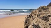 рыбаки : Beach with rocks in Almograve Alentejo Portugal Стоковые видеозаписи