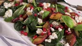 spinach : Fresh vegetable salad with grilled peach, pomegranate, spinach and fresh cheese.