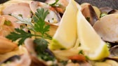 mussel dish : Traditional italian seafood pasta with clams Spaghetti alle Vongole. Stock Footage