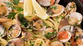clams : Traditional italian seafood pasta with clams Spaghetti alle Vongole. Stock Footage