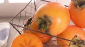 вкусный : Delicious fresh persimmon fruit on kitchen countertop. Стоковые видеозаписи