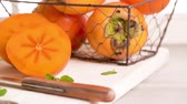 biurko : Delicious fresh persimmon fruit on kitchen countertop. Wideo