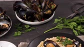 mediterranean mussel : Homemade pasta spaghetti with mussels , peppers and parsley on rustic background. sea food meal. Stock Footage