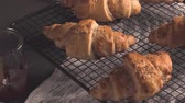 kruvasan : Baked croissants with strawberry jam on a kitchen countertop. Stok Video
