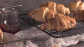 kara tahta : Baked croissants with strawberry jam on a kitchen countertop. Stok Video
