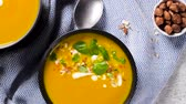 Healthy Pumpkin soup with cream and organic pumpkin seeds.