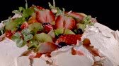 amoras : Pavlova cake with fresh blueberries, strawberries and kiwi.